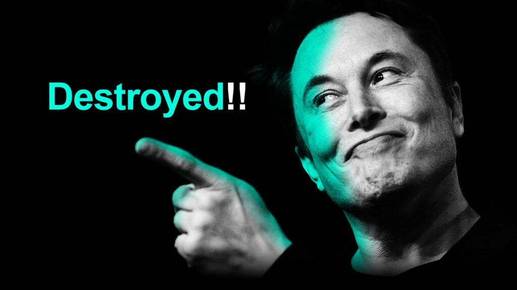 Elon Musk with a pointing finger gesture.