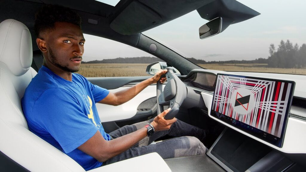 Marques Brownlee (MKBHD) in his black Tesla Model S Plaid.