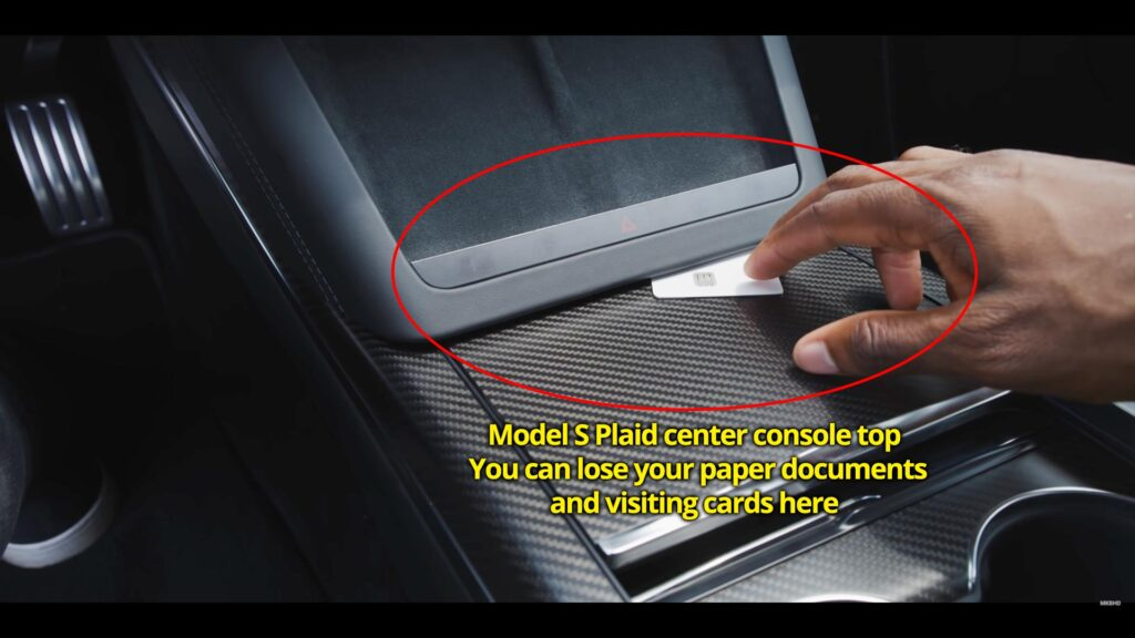 Model S Plaid: Papers and thin objects can slide down this narrow space between the center console top and under the wireless charging dock.
