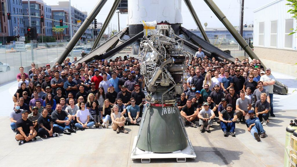 SpaceX rocket engineers celebrating the 100th build of the Raptor engine.