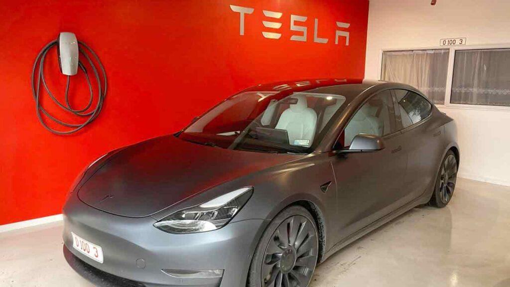 Tesla Model 3 in Midnight Silver Metallic at a Tesla Store.