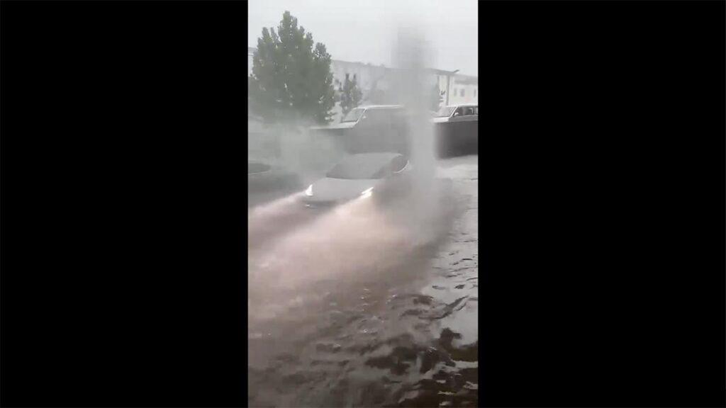 Tesla Model 3 wading through a flood in China.