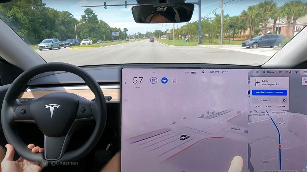 FSD Beta V9.2 driving visualizations on a Tesla Model 3 center touchscreen (video in article).