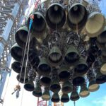 SpaceX Super Heavy Booster 4 rocket being lifted on to the launch pad at Boca Chica, Texas launch site.