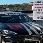 Randy Pobst with his Unplugged Performance Tesla Model S Plaid after scoring the best EV lap record at the Laguna Seca Raceway (video in article).