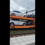 Tesla cars getting transported on a train in Europe.